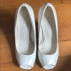 White peep toe high heels. Does have few scratches